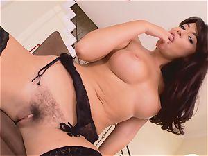 Ava Dalush playing her fluffy slit