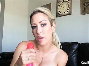 Capri plays with her humungous dildo