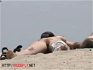 big-chested bare beach babes filmed by a spycam